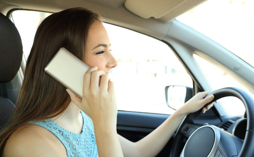 Distracted driver calling on phone driving a car